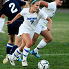 Danvers:<br /> Danvers' Chrissy Gikas snags the ball with the help of Shannon Pohle from Andover's Michelle Gagnon during the Andover at Danvers girls soccer game at Deering Stadium.<br /> Photo by Ken Yuszkus/The Salem News, Monday, September 10, 2012.