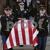 Beverly:<br /> The flag draped casket of Stephen R. Fortunato, who died in Afghanistan, is carried out of St. Mary Star of the Sea Church after the funeral mass. Elizabeth Crawford, Stephen's mother follows behind the casket.<br /> Photo by Ken Yuszkus/Salem News, Friday, October 24, 2008.