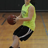 Danvers:<br /> Whitney Comeau, a senior at Essex Aggie, received the ball during tryouts for girls basketball.<br /> Photo by Ken Yuszkus/Salem News, Friday, December 3, 2010.