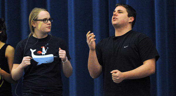 "Beverly:<br /> Carly Moffie, who plays Millie, and Marc Babcock, who plays Jimmy, in the Beverly High School play, ""Thoroughly Modern Millie"", rehearse on stage Tuesday afternoon.<br /> Photo by Ken Yuszkus/Salem News, Tuesday,  February 28, 2012."