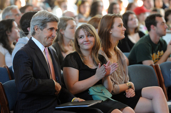 Wenham:<br /> Senator John Kerry, left, readies to stand and move to the podium to give his speech at A. J. Gordon Memorial Chapel at Gordon College. To the right of him is Jennifer Hyde and Dawn Cianci, both Gordon College sophmores. <br /> Photo by Ken Yuszkus/Salem News, Monday,  March 19, 2012.