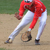 Salem;<br /> Ben Kapnis grabs the ball while covering first base while warming up before the Salem High baseball scrimmage with North Reading.<br /> Photo by Ken Yuszkus/Salem News, Thursday, April 5, 2012.