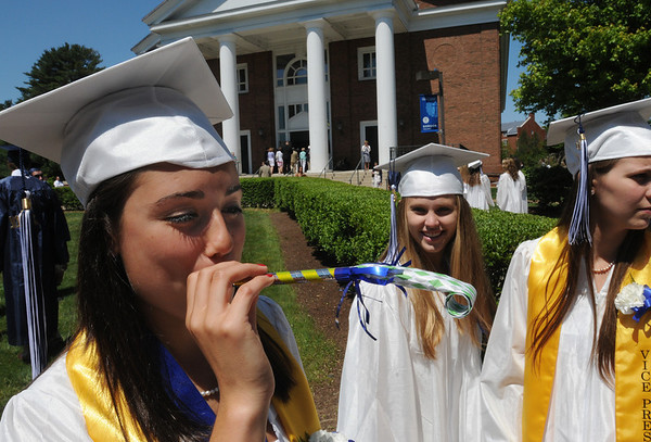 Wenham:<br /> From left, Hamilton-Wenham graduates Katie Flores, with the party favor, Molly Curtis, and Danielle Carp stand in front of the Gordon College Chapel before the start of their graduation exercise which was held inside the chapel at noon on Sunday.<br /> Photo by Ken Yuszkus/Salem News, Sunday, June 5, 2011.