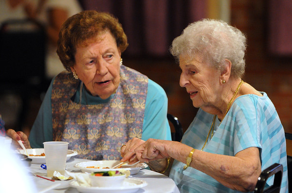 Salem:<br /> Delia Riley, left, and Jacqueline Silva talk while eating their dinner at the Moose Hall Thursday evening. Salem's seniors had gathered to enjoy dinner and dancing.<br /> Photo by Ken Yuszkus/Salem News, Thursday, August 11, 2011.