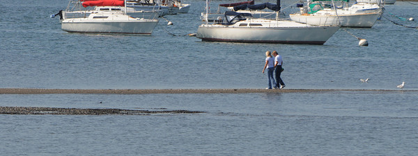 Salem:<br /> A couple walk on the stretch of exposed shoreline in Salem Harbor at low tide.<br /> Photo by Ken Yuszkus/The Salem News, Friday, September 14, 2012.