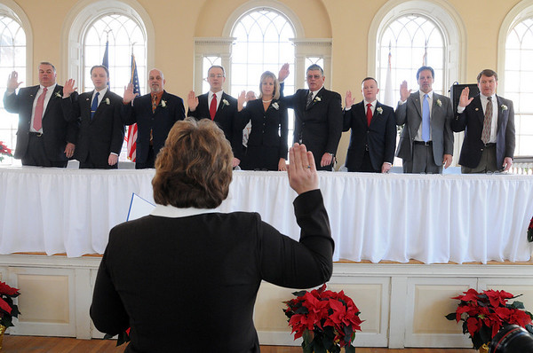 Salem:<br /> Cheryl Lapointe, city clerk, administers the oath of office to city council members during the inaugural ceremony at Old Town Hall.<br /> Photo by Ken Yuszkus/Salem News, Monday, January 4, 2010