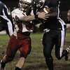 Peabody:<br /> Salem's Davis Walsh eventually wrestles Peabody's Nat Gaye to the ground during the Salem at Peabody football game at Coley Lee Field Friday night.<br /> Photo by Ken Yuszkus/Salem News, Friday, September 9, 2011.