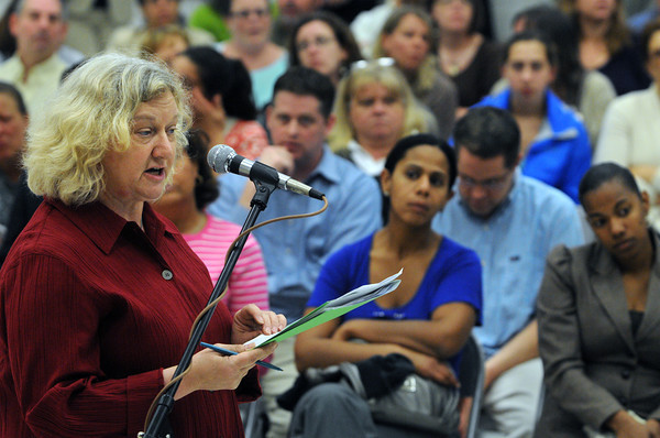 Salem:<br /> Julie Carter, principal at the Saltonstall School, speaks about her school in front of the crowd at the start of the Salem School Committee meeting held at the Bentley Elementary School.<br /> Photo by Ken Yuszkus/Salem News, Monday, May 21, 2012.