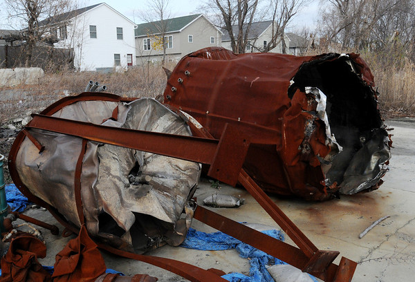 Danvers:<br /> Metal debris lays on the site of the blast which happened 5 years ago in Danversport . Houses in the background have been built since the explosion.<br /> Photo by Ken Yuszkus/Salem News, Tuesday, November 22, 2011.