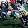 Danvers:<br /> St. John's Prep Eric Clopper drives the ball down the field during the Malden Catholic at St. John's Prep rugby game.<br /> Photo by Ken Yuszkus/Salem News, Thursday, April 15, 2010.