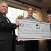 Danvers:<br /> Mayor Scanlon, left, and Patricia Cirone, right, accept the check for $25,000 dollars from Brad Gaige, center, president of the Rotary Club of Beverly, for the Beverly Bookmobile. The meeting of the Rotary Club of Beverly took place at the Danversport Yatch Club.<br /> Photo by Ken Yuszkus/Salem News, Thursday, May 6, 2010.