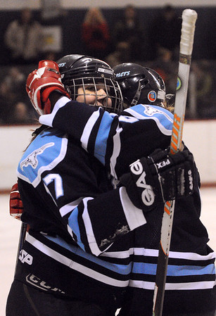 Peabody:<br /> Peabody's Lauren White, left, gets a hug from her teammate, Laura Miele, just after Lauren scored a goal during the Bishop Fenwick at Peabody girls hockey game at the McVann O'Keefe Rink.<br /> Photo by Ken Yuszkus/Salem News, Monday, December 26, 2011.