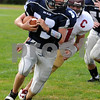 Swampscott:<br /> Swampscott's Jake McDougall runs with the ball with Gloucester right behind him at the Swampscott vs Gloucester foootball game at Blocksidge Field.<br /> Photo by Ken Yuszkus/Salem News, Sunday, September 13, 2009.