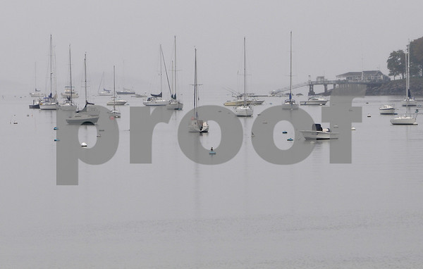 Salem:<br /> A light fog envelopes Salem Harbor on a cold rainy morning.<br /> Photo by Ken Yuszkus/Salem News, Tuesday October 13, 2009.