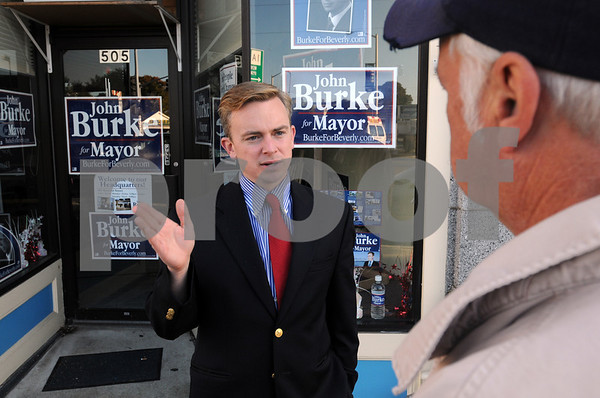 Beverly:<br /> Beverly mayoral candidate John Burke talks to Bill Simpson in front of his campaign headquarters.<br /> Photo by Ken Yuszkus/Salem News, Monday October 19, 2009.
