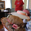 Peabody:<br /> In the foreground is a hat from 1923-1925. Anne Birkner, office manager, looks over the selection of hats which was part of the Hats Off to History and Art exhibit.<br /> Photo by Ken Yuszkus/Salem News, Thursday, July 7, 2011.