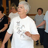 Danvers:<br /> Bette Mello dances in a line dance at the Danvers Council on Aging.<br /> Photo by Ken Yuszkus/Salem News, Wednesday, June 15, 2011.