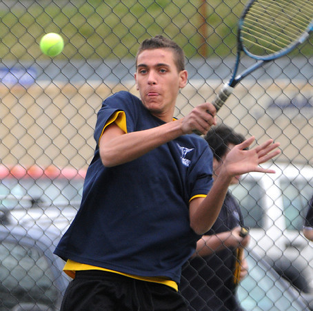 Swampscott:<br /> Peabody's Cody Famiglietti belts the ball during the Peabody at Swampscott boys tennis match at Swampscott Middle School tennis courts.<br /> Photo by Ken Yuszkus/Salem News, Monday, April 9, 2012.