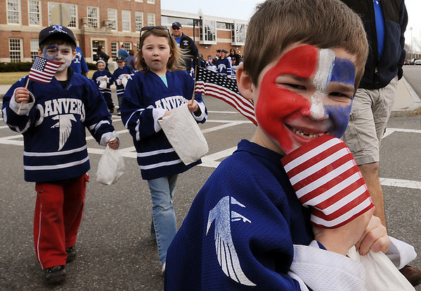 Danvers:<br /> Jimmy Thibedeau, of the Danvers Youth Hockey Mite Instructional Team, marches in the parade to honor Meghan Duggan, 2010 U.S. women's hockey silver medalist from Danvers, <br /> Photo by Ken Yuszkus/Salem News, Sunday, March 21, 2010.