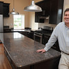 Danvers:<br /> Developer John Thomson is in the kitchen of one of the new condo units at the old stone barn which was part of the Homes For the Deaf property.<br /> Photo by Ken Yuszkus/Salem News, Thursday, June 23, 2011.