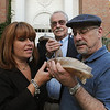 Salem:<br /> From left, Pam Stein, Herb Belkin, and Larry Taitelbaum hold a shofar in front of the Temple Shalom in Salem. Herb Belkin is relinquishing his duty of blowing the shofar to Pam Stein and Larry Taitelbaum. <br /> Photo by Ken Yuszkus/Salem News, Monday, September 12, 2011.