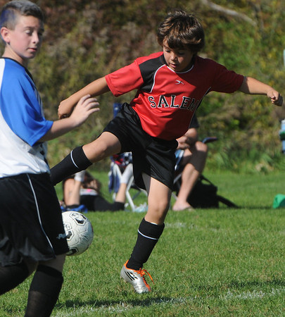 Peabody:<br /> Salem's Adam Pinto controls the ball during the Peabody vs Salem U12 game during the Peabody Youth Soccer's annual Columbus Day Tournament at Kennedy School fields.<br /> Photo by Ken Yuszkus/Salem News, Monday, October 10, 2011.