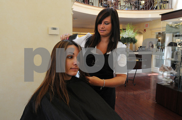 Salem:<br /> Abby D'Orsi, stylist, discusses  options for Alyssa McGarvey's hair at Andrew Michaels Spa Salon.<br /> Photo by Ken Yuszkus/Salem News, Wednesday, July 15, 2009.