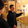 Middleton:<br /> Ian  Lefavour, electrical student, right, explains the electrical program to Eddie Basso, of Gloucester, who is visiting North Shore Tech's Open House on Thursday evening.<br /> Photo by Ken Yuszkus/Salem News, Thursday, November 10, 2011.