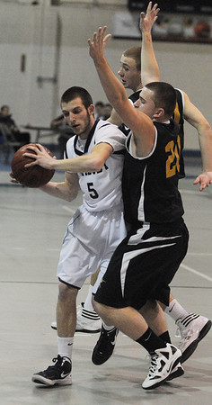 Peabody:<br /> Peabody's Jason Hiou looks for the net with Bishop Fenwick's Josh Gustin, right, and Ben Maxner covering him during the Bishop Fenwick at Peabody boys basketball.<br /> Photo by Ken Yuszkus/Salem News, Monday, January 23, 2012.