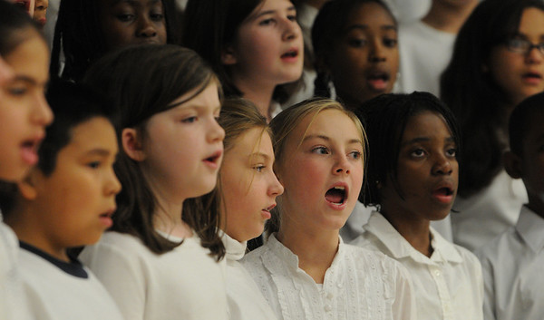 Salem:<br /> Students sing on stage during the Bentley Chorus Winter Concert at Bentley Elementary School in Salem on Tuesday night.<br /> Photo by Ken Yuszkus/Salem News, Tuesday,  December 7, 2010.