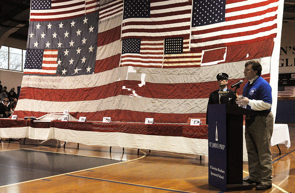 Danvers:<br /> Jeff Parness speaks at the podium near the National 9/11 Flag at St. John's Prep during the ceremony Thursday morning. <br /> Photo by Ken Yuszkus/Salem News, Thursday, March 24, 2011.