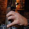 Salem:<br /> A closeup of Dimitri Eleftherakis' hand on the neck of the bass at the Gulu Gulu Cafe.<br /> Photo by Ken Yuszkus/Salem News, Monday, December 28, 2009.