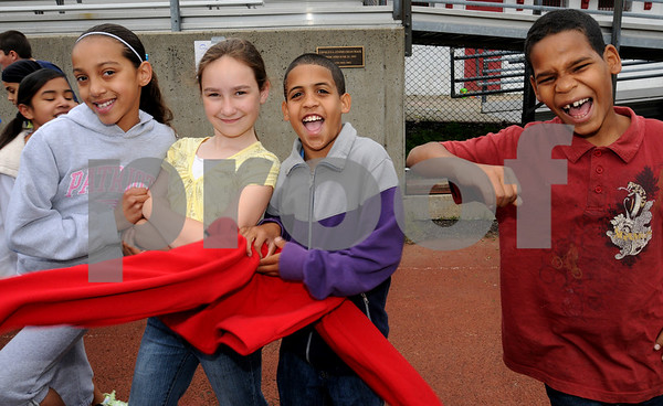 Salem:<br /> From left, Julia Destefano, Lydia Magliaro, Alex Sanchez, and Juan Daniel, all fifth grade students, pose for a photo at the field day activities. Witchcraft Heights Elementary School was having a field day at Bertram Field.<br /> Photo by Ken Yuszkus/Salem News, Monday, June 15, 2009.