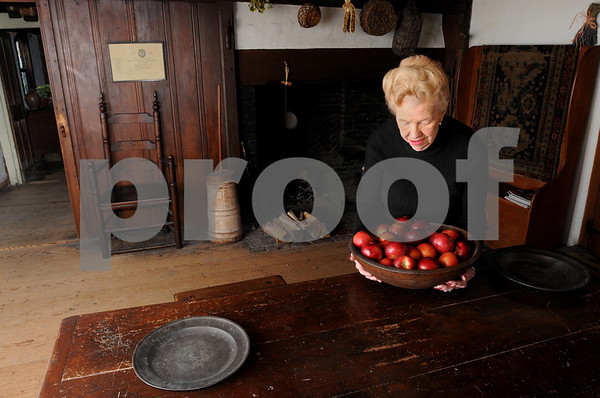 Beverly:<br /> Nancy Peabody-Hood, holding a bowl of apples, stands next to the table at the Balch House where the Thanksgiving dinner will be served to the winner of the raffle which benefits the  Beverly Historical Society.<br /> Photo by Ken Yuszkus/Salem News, Tuesday, November 4, 2008.