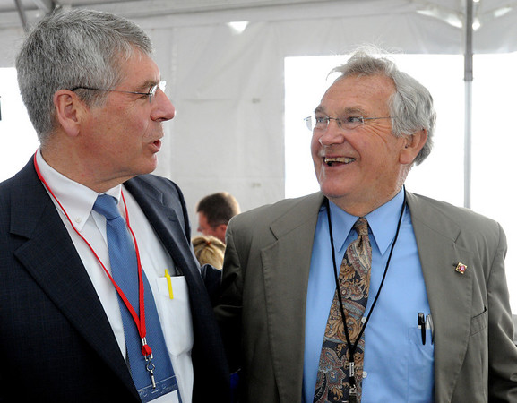 Salem:<br /> Paul Passeri, left, of Salem Five Bank, speaks with Fred Schmid the owner of Crystal Systems, which was bought by GT Solar, at the GT Solar ribbon cutting on Tuesday morning.<br /> Photo by Ken Yuszkus/Salem News, Tuesday, June 14, 2011.