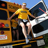 Middleton:<br /> Ashley Steeves, left, and Brandi Dion jump out the  back exit door of a school bus. They will be participating in an extreme run on Sunday in Salem.<br /> Photo by Ken Yuszkus/Salem News, Thursday, June 2, 2011.
