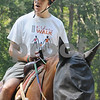Topsfield:<br /> Don Summerfield of Cambridge, rides Clifford the horse. The free program for physically disabled people to be able to ride a horse was held at the Bradley Palmer State Park.  <br /> Photo by Ken Yuszkus/Salem News Friday, September 05, 2008