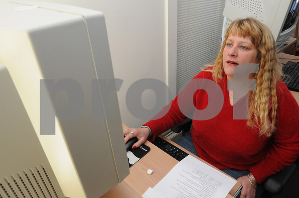 Beverly:<br /> Patricia Brown of Beverly, works on the computer at Bootstraps Community Services. She belongs to the new program which teaches life skills to low-income adults in Beverly.  It's a combination of computer skills and 'survival' skills that will enable people to apply for and keep jobs and manage their household finances.<br /> Photo by Ken Yuszkus/Salem News, Wednesday December 3, 2008.