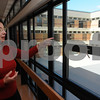Salem:<br /> Darleen Mellis, school building committee chairman, speaks about the old courtyard while looking out from one of the three cafeterias toward the area of the courtyard during the tour of the newly renovated Salem High School. <br /> Photo by Ken Yuszkus/Salem News, Monday September 15, 2008.