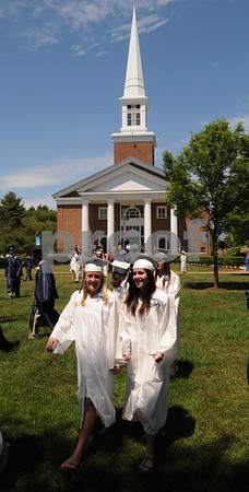 Wenham:<br /> Stephanie Ozahowski, left, and Lauren Fischer get ready to line up for the processional which will march into the Gordon College chapel, in the background, for the graduation ceremonies of Hamilton-Wenham High School.<br /> Photo by Ken Yuszkus/Salem News, Sunday, June 7, 2009.