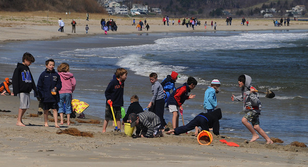 Ipswich:<br /> People swarm Crane beach on Monday. It was a free family fun day. Besides the free admission, there were activities for all ages during the day.<br /> Photo by Ken Yuszkus/Salem News, Monday, April 18, 2011.