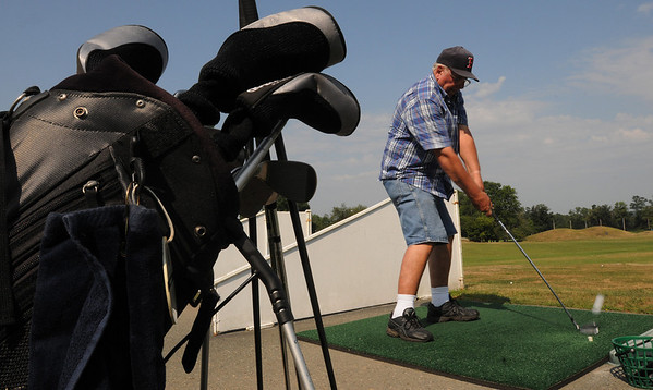 Danvers:<br /> Bob Smith wallops the golf ball for a long one at the driving range at Sun' N Air Golf Center in Danvers early Monday morning.<br /> Photo by Ken Yuszkus/Salem News, Monday August 9, 2010.