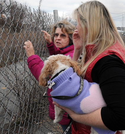 Danvers:<br /> Janet Lettich, left, and Katie Turcotte look at the site of the explosion on the 3-year anniversary of the explosion.<br /> Photo by Ken Yuszkus/Salem News, Sunday November 22, 2009.