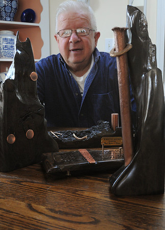 "Beverly:<br /> Norman ""Dugie"" Russell dove on the sunken wreck of the U.S.S. New Hampshire off Singing Beach in Manchester. The artifacts that he recovered are fashioned into pieces of art which he sells.<br /> Photo by Ken Yuszkus/Salem News, Friday,  April 8, 2010."