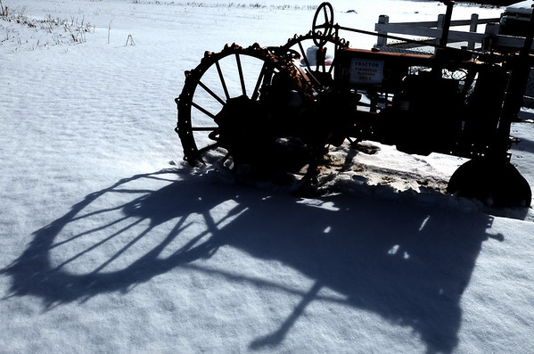 Danvers:<br /> The winter sun casts a long shadow from the antique tractor onto the snow at Connors Farm in the early afternoon.<br /> Photo by Ken Yuszkus/Salem News, Friday, January 22, 2010.