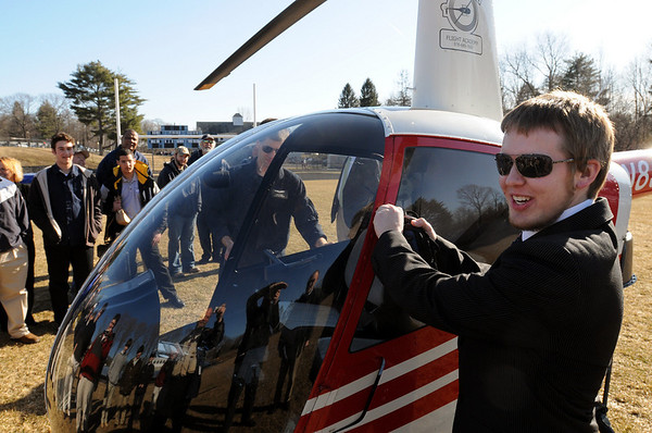 Danvers:<br /> St. John's Prep, senior Erik Slettehaugh, right, of Groveland, piloted a helicopter over the Cronin Stadium field at St. John's Prep school where he eventually landed.<br /> Photo by Ken Yuszkus/Salem News, March 10, 2010.