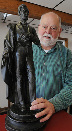 Danvers:<br /> Alan Hartnett is well known as a local car wash owner, but he's also an avid collector of political memorabilia. He has a statue of Abraham Lincoln which he recently acquired. <br /> Photo by Ken Yuszkus/Salem News, Wednesday, February 8, 2012.