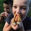 Danvers:<br /> Reese MacDonald, 5 1/2, right, and her brother Maddox, 4, enjoy their hot dogs at the start of the Danvers Family Festival at Glen Magna Farms Monday evening.<br /> Photo by Ken Yuszkus/Salem News, Monday, June 27, 2011.