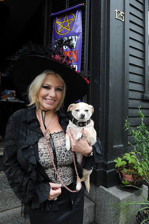 Salem:<br /> Laurie Stathopoulos with her dog, Chico, in front of Crow Haven Corner on Essex Street.<br /> Photo by Ken Yuszkus/Salem News, Monday,  October 4, 2010.