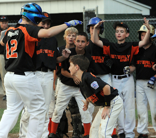 Beverly:<br /> Beverly East's Michael Urbanski is congratulated by his teammates as he heads for the dugout after hitting a homerun during the Beverly West vs. Beverly East in District 15 Little League Williamsport all-star game at Harry Ball Field.<br /> Photo by Ken Yuszkus/Salem News, Monday, July 2,  2012.